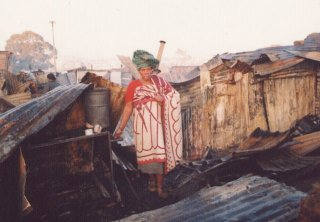 Nofenishala Khonjo amid the wreckage of what was once her home