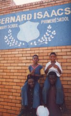 Khumbulani and Bongani, sitting on the shoulders of Children of Fire volunteers Collen Mudau and Aron Stout